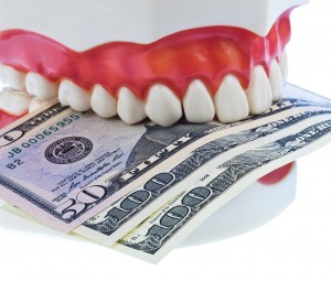 fake teeth and money