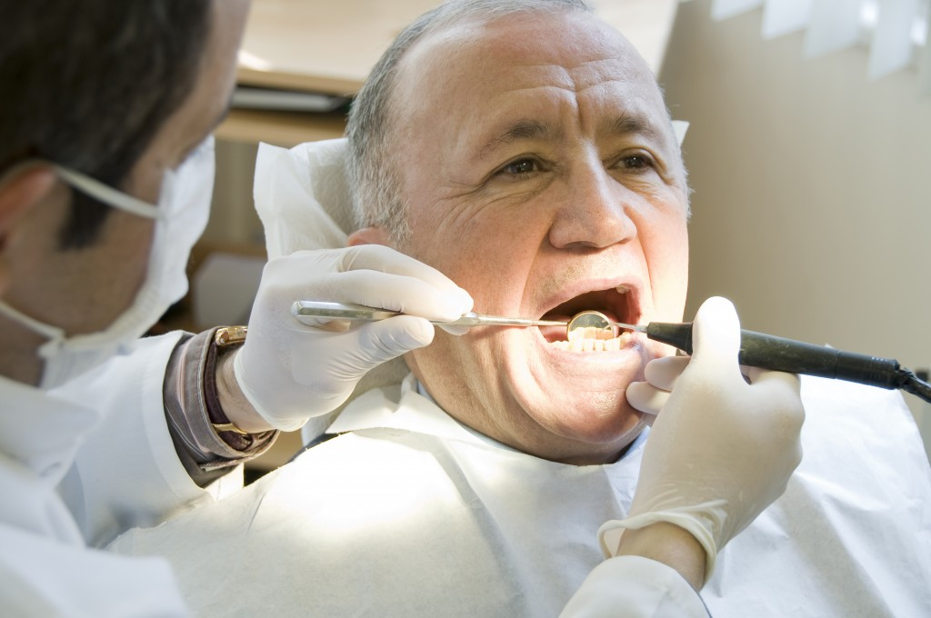 man receiving check up at dentist